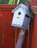 Abandoned Bird House. By Fence royalty free stock image
