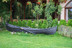 Abandoned black boat in courtyard Stock Images