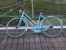Abandoned blue bicycle on wooden dock Stock Photography