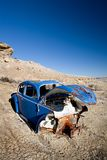 Abandoned blue car Royalty Free Stock Photography