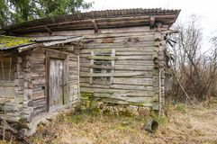 Abandoned boarded up door entrance to rural wooden house Stock Image
