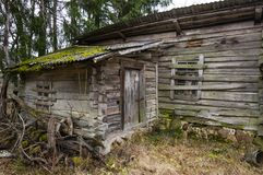 Abandoned boarded up door entrance to rural wooden house Royalty Free Stock Photo