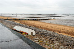 Abandoned boat. An abandoned boat on a rainy day (Three Shells Beach, Southend-on Sea Royalty Free Stock Image