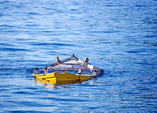 Abandoned boat. Abandoned small wooden fishing boat sunk in the sea Royalty Free Stock Photos