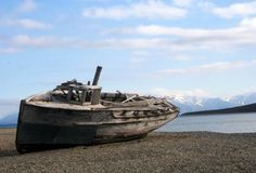 Abandoned Boat. An old wooden boat resting on the shore Stock Photo
