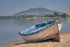 Abandoned boat. Abandoned fisherman boat on the shore of the Adriatic sea Royalty Free Stock Images