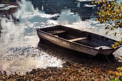 Abandoned boat in autumn leaves Royalty Free Stock Images