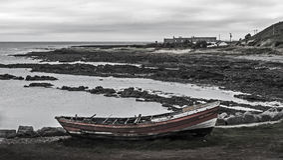 Abandoned Boat on Bleak Coastline. Abandoned boat on bleak coast, Gourdon, Scotland Royalty Free Stock Photography