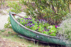Abandoned boat decorated with flowers Stock Photo