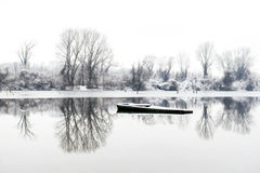 Abandoned boat frozen in a lake Stock Images