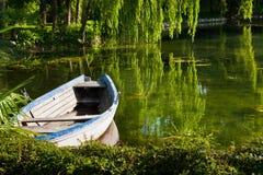 Abandoned boat on the lake Stock Photo