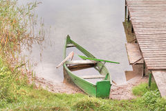 Abandoned boat on a lake shore Stock Photo