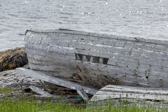 Abandoned boat by ocean Royalty Free Stock Image