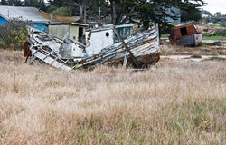 Abandoned boat. Old dilapidated boat rots in a field Royalty Free Stock Image