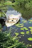 Abandoned boat. Old sunken plastic boat in the lake Royalty Free Stock Image