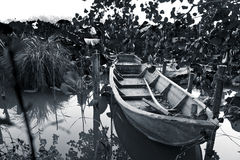 The abandoned boat. Photos of old boat in lake Stock Photos