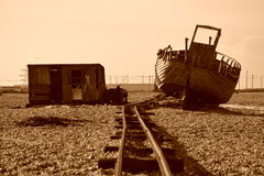 Abandoned boat, rail track and hut on beach. Abandoned boat, rail track and hut on a deserted beach near a powerplant Stock Images