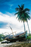 Abandoned boat by river bank Royalty Free Stock Image