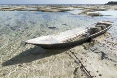 Abandoned boat at the seagrass plantation, Nusa Lembongan, Bali, Indonesia. Abandoned boat at the seagrass plantation with blue water, Nusa Lembongan, Bali stock image