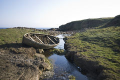 Abandoned boat by stream in peat Royalty Free Stock Photos