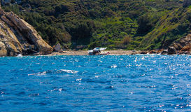 An abandoned boat. A boat used by the refugees abandoned on the Mediterranean coast royalty free stock image