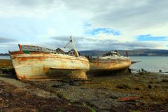 Abandoned boats on beach Royalty Free Stock Images