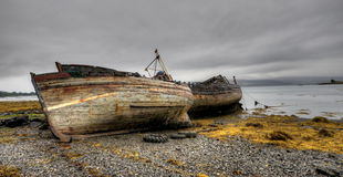 Abandoned boats in the coast Royalty Free Stock Images