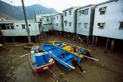 Abandoned boats in dried river of old fishermen village Tai O with rustic metal blocks Stock Photos