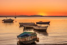 La Manga del Mar Menor at sunset. Abandoned boats and others for recreation and fishing in the Mar Menor, a saltwater lake Royalty Free Stock Photo