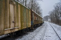 Abandoned Boxcars in the Snow. Old abandoned boxcars on a rail siding in the snow Stock Photo