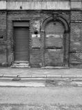 Abandoned brick building with bricked up door Stock Image