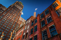 Abandoned brick building and highrise in Baltimore, Maryland. Stock Photography