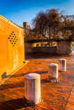 Abandoned brick building and posts at Old Town Mall, in Baltimor. E, Maryland Royalty Free Stock Photo