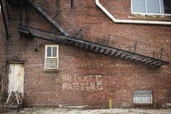 Abandoned Brick Building With Metal Staircase