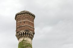 Abandoned brick and concrete water tower stock images