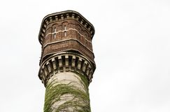 Abandoned brick and concrete water tower stock photos