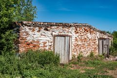Abandoned brick cowshed Stock Photo
