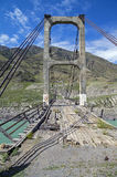 Abandoned bridge over the river Katun, Altai, Russia. Royalty Free Stock Images