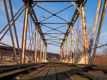 Abandoned bridge to the old factory Royalty Free Stock Image