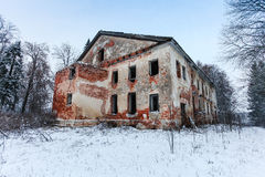 Abandoned and broken old two-storey brick house in the forest Royalty Free Stock Image