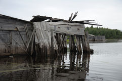 Abandoned and broken slip docs in a lake. The picture shows abandoned and broken slip docs in a small settlement in Russia's Karelia region royalty free stock images