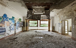 Abandoned building. Large room, debris on the floor Stock Photography