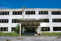 Abandoned building. With broken windows. Front view Royalty Free Stock Photo