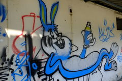 Spray Paint Bunny. An abandoned building in Bangkok, Thailand serves as the canvas for urban art royalty free stock photo
