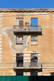 Abandoned building - broken tenement apartment house Royalty Free Stock Photo