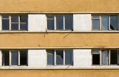 Abandoned building with broken windows. Old abandoned building with old windows and broken glass Royalty Free Stock Photo