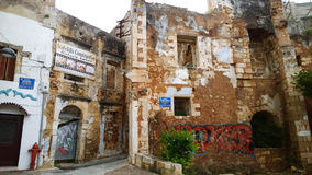 An abandoned building in the center of Chania with modern graffiti on it Stock Photography