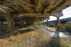 Abandoned building. Damaged industrial facilities. View of an abandoned building. Empty damaged industrial facilities in Greece royalty free stock photo