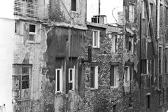 Close-up of poor homes at a deprived area of Piraeus, Greece. Black and white photo Stock Photos