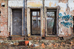 Abandoned building facade. Left abandoned building facade - with graffity Stock Images